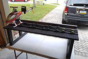 Carpeted transport platformwith Random Heli T-Track and Skid Clamps