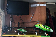 Two RC Helicopters secured to shelf in RV using Skid Clamps