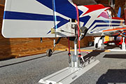 Random Heli Gear Jacks Tail Support mounted on Gladiator Gear Track in cargo trailer