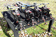 Four Goblin helis secured for transport in mini van using T-Track and Skid Clamps from Random Heli