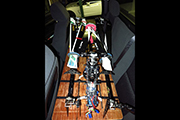 Three RC Helicopters secured to board on rear seat of crew cab pickup truck