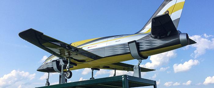 RC Jet secured (tied down) to field cart using Random Heli Gear Jacks Fuselage Support Assemblies