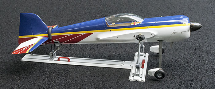 RC airplane secured (tied down) for transport in a truck, trailer, or SUV.
