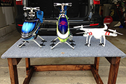 Quad copter, multi-rotor heli using Skid Clamps for transport in vehicle