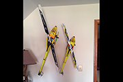 RC Helicopters mounted on wall as art. Random Heli Skid Clamps hold models on angles