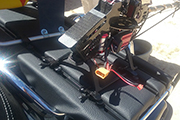 RC heli on back of motorcycle uses Random Heli Skid Clamps and T-Track