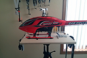 SAB Goblin 700 RC Heli mounted on work stand using Random Heli Skid Clamps (clips)