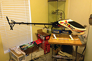 RC Helicopter mounted on board for work stand using landing skid (clips) clamps
