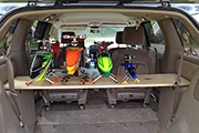 Four RC helicopters mounted on platform in Minivan for transport