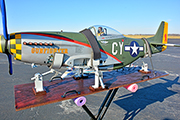 Large Radio Controlled P51 airplanes are transported on a slide-out platform and secured with Random Heli Gear Jacks.
