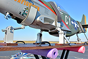 RC warbird (P51) tied down for transport in trailer using Random Heli Gear Jacks.