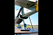 Padded bungee is used to secure large RC airplane for transportation in trailer.