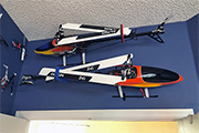 RC Helicopters mounted horizontally on wall using Skid Clamps