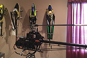 Four RC Helicopters mounted on wall using Random Heli Skid Clamps