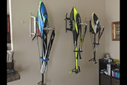 RC Helicopters hanging on wall with Random Heli Skid Clamps