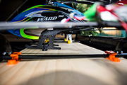 Compass Warp 360 RC heli is secured for transport in pickup truck using Random Heli STC9000 Skid Clamp