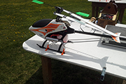 Skid Clamps hold RC helicopter on table at flying field
