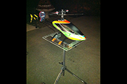 Furion 6 on custom  RC Helicopter stand is secured by Random Heli Skid Clamps
