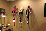 Three RC Helicopters mounted to wall using Random Heli Skid Clamps