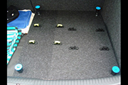 Custom platform for transporting RC helicopters in the back of a small car using Random Heli Skid Clamps.