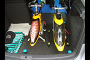 Custom platform for transporting two nitro helicopters in the back of a small car using Random Heli Skid Clamps.