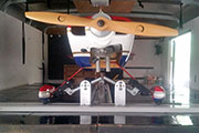 Gear Track and Gear Jacks mounted on shelf in cargo trailer for RC airplane transport