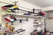 RC heli mounted to underside of adjustable shelving using Skid Clamps