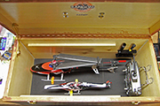 Two RC helicopters in transport box