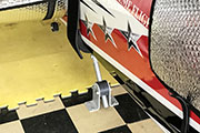 Gear Jack Tail Support is mounted to floor of RC airplane trailer.