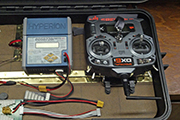 Random Heli Skid Camps used to secure RC radio transmitter in charger case