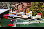 Large Radio Controlled airplanes are transported on a slide-out platform and secured with Random Heli Gear Jacks.