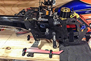 SAB Goblin Speed heli is secured for transport using modified Random STC6377LP Heli Skid Clamps.