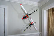 RC helicopters mounted on wall using landing skid clip clamp