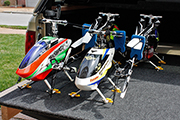 RC Helicopters mounted on board for transport using landing skid clip clamps