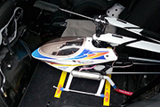 Skid Clamps hold RC heli on back of mini-van seat